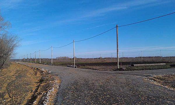 Фото коттеджный посёлок Рябиновый, осень 2012. Завершено строительство линий электропередач и внутриквартальных дорог. Фото с сайта застройщика.